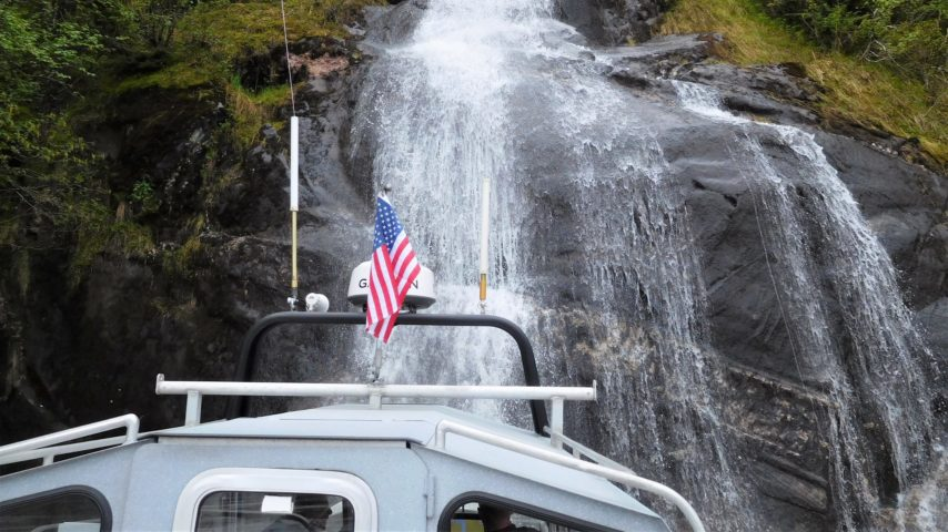 Boat up close to a waterfall on Stikine River