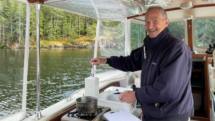 David in the galley aboard Wayward Sun
